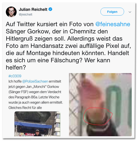 Screenshot eines Tweets von Julian Reichelt - Auf Twitter kursiert ein Foto von Feine-Sahne-Sänger Gorkow, der in Chemnitz den Hitlergruß zeigen soll. Allerdings weist das Foto am Handansatz zwei auffällige Pixel auf, die auf Montage hindeuten könnten. Handelt es sich um eine Fälschung? Wer kann helfen?