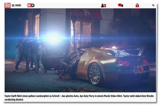 Screenshot aus dem Musikvideo von Taylor Swift mit der Bildunterschrift von Bild.de - Taylor Swift fährt einen gelben Lamborghini zu Schrott – das gleiche Auto, das Katy Perry in einem Musik-Video fährt. Taylor sieht dabei ihrer Rivalin verdächtig ähnlich