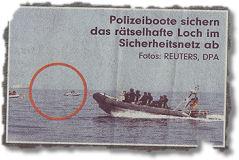 Polizeiboote sichern das rätselhafte Loch im Sicherheitsnetz ab